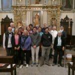 Le prêtre dans l'équipe accueillant les pèlerins francophones